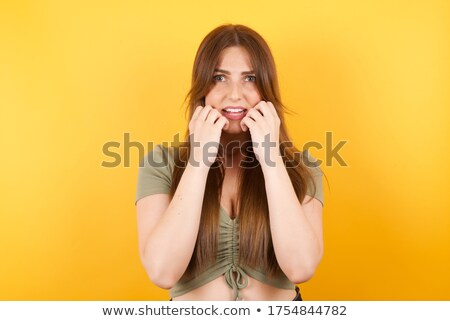 Fotografia bać kobieta zielone sweter Zdjęcia stock © deandrobot