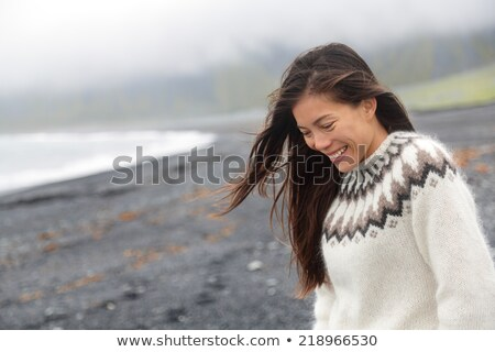 Winter iceland sweater Asian woman model wearing traditional wool knit icelandic clothing wear. Pret Stock photo © Maridav