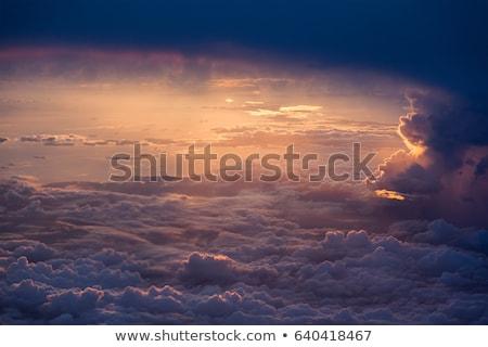 Fantastik güneş bulutlar üzerinde deniz mavi gökyüzü Stok fotoğraf © lypnyk2