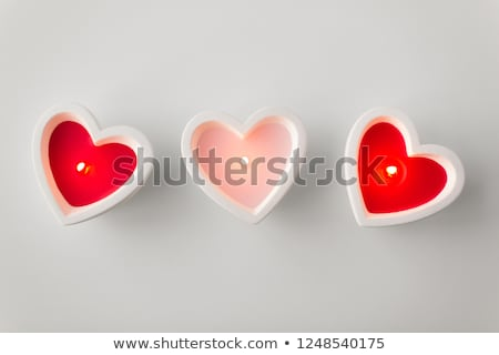 Stock photo: Burning red heart shaped candle