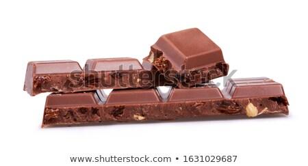 stack pile of peanuts and raisins on white stock photo © bobbigmac