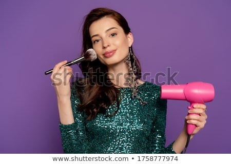 Woman holding a hair dryer and brush Stock photo © photography33