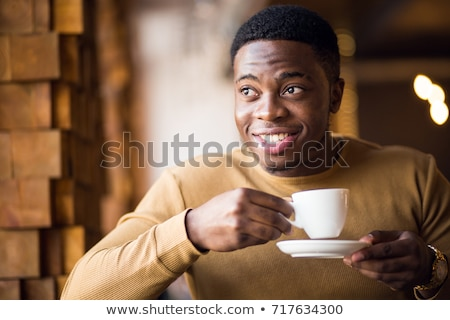 young man drinking tea stock photo © elly_l