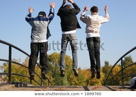 человека прыжки из за дерево трава Сток-фото © photography33