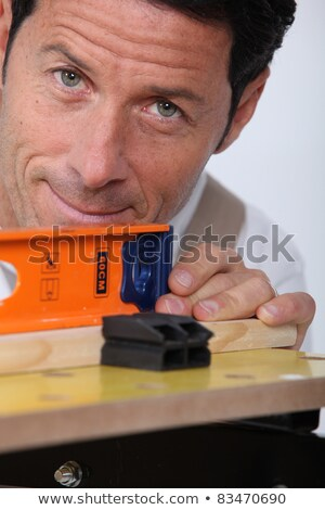 closeup of a man using a laser lever stock photo © photography33