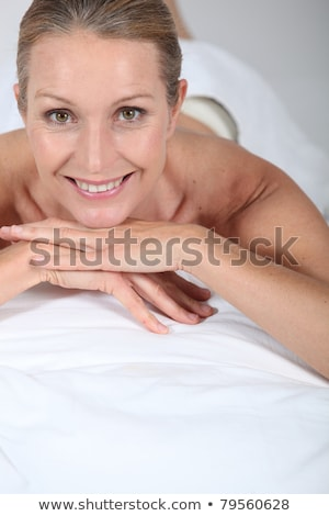 Blond woman laid on front awaiting massage Stock photo © photography33