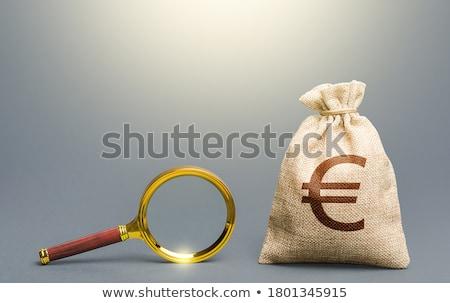 euro in glass stock photo © shutswis