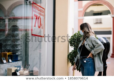 Smartly dressed woman with hands on her waist Stock photo © stockyimages