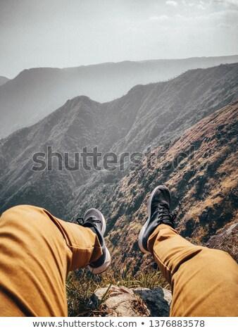 Nogi niebo kobiet Błękitne niebo chmury kobieta Zdjęcia stock © dolgachov