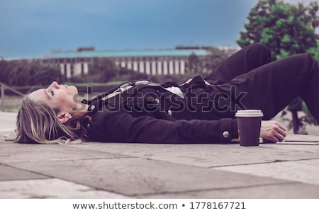 Businesswoman lying on the floor with her laptop Stock photo © photography33