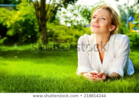 portrait of a woman on the grass stock photo © photography33