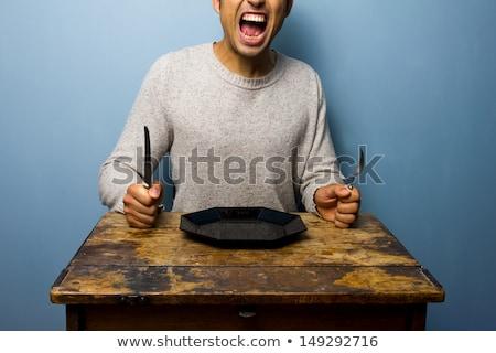 Faminto homem mesa de jantar sessão garfo faca Foto stock © stevanovicigor