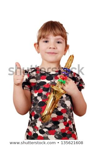 Meisje duim omhoog saxofoon muziek gelukkig Stockfoto © goce