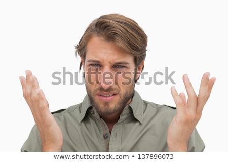 Irritated man gestuing at camera stock photo © wavebreak_media