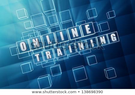 online training in blue glass cubes stock photo © marinini