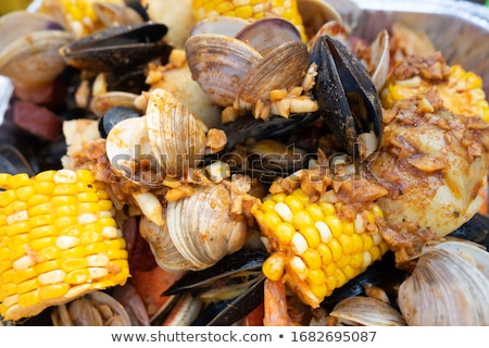 Shrimp and clam seafood appetizer. Stock photo © DonLand
