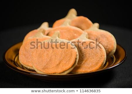 Homemade pumkin cookies on isolated black stock photo © shanemaritch