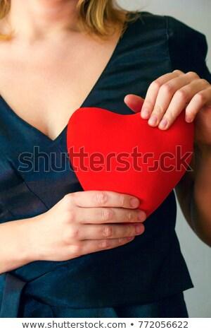 Kız kırmızı elbise kalp sevgililer günü mavi bokeh Stok fotoğraf © fotoatelie
