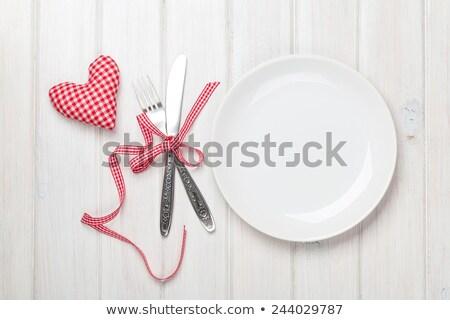 игрушку сердце пластина столовое серебро деревянный стол Сток-фото © karandaev