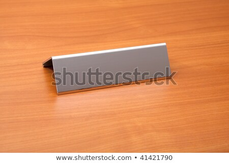 A blank metal name plate on a desk. Ready for text to be added.  Stock photo © inxti