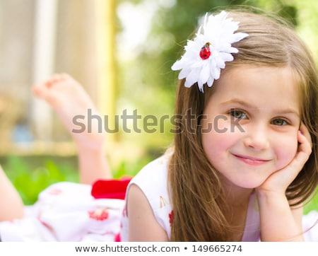 verlegen · meisje · portret · outdoor · park - stockfoto © hasloo