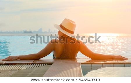 Sexy · расслабляющая · океана · женщину · пляж - Сток-фото © amok