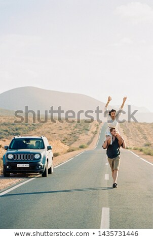 Young man in countryside with SUV Stock photo © monkey_business