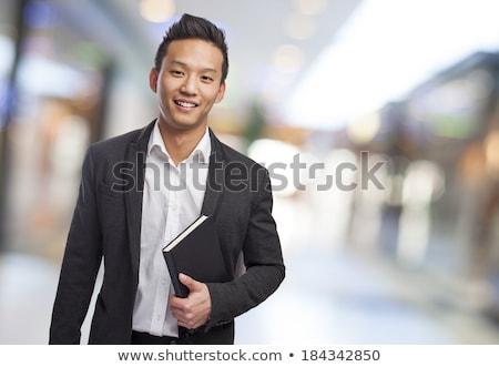 imaturo · homem · de · negócios · asiático · estúdio · cinza · escritório - foto stock © elwynn