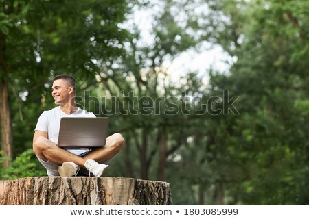 casual fashion man sitting on a tree stump  Stock photo © feedough