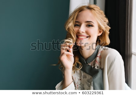 close up happy blond girl touching her hair stock photo © stryjek