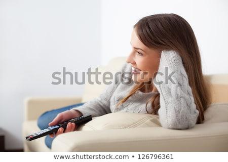 Bella telecomando divano home donna Foto d'archivio © deandrobot