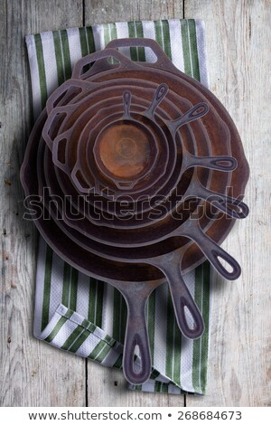 Collection of round rusty cast iron frying pans Stock photo © ozgur