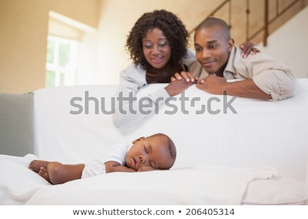 Baby boy sleeping peacefully on couch with father  Stock photo © wavebreak_media