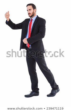 Unsmiling businessman standing with hand raised Stock photo © wavebreak_media