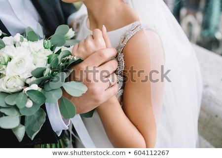 vőlegény · menyasszony · asztal · étterem · virágok · esküvő - stock fotó © hasloo