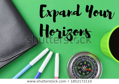 Handwritten Expand Your Horizons on a Chalkboard. Stock photo © tashatuvango