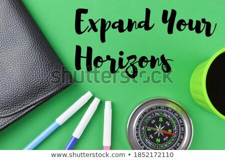 handwritten expand your horizons on a chalkboard stock photo © tashatuvango
