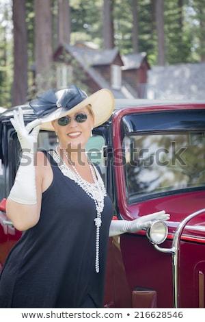 vrouw · twintiger · antieke · auto · aantrekkelijke · vrouw · interieur - stockfoto © feverpitch