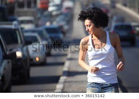 girl runs on highway middle in city stock photo © paha_l