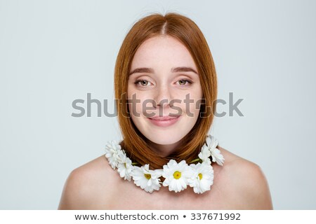 Happy redhair woman with neck of flowers Stock photo © deandrobot