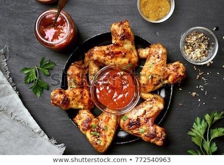Mariné poulet ailes bois viande plat Photo stock © Digifoodstock