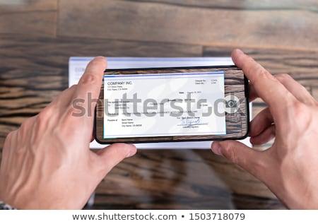 Biznesmen telefonu komórkowego obraz młodych spaceru komórkowych Zdjęcia stock © RazvanPhotography
