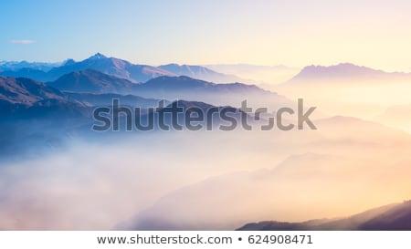 Paisaje niebla montanas árboles puesta de sol Foto stock © byrdyak