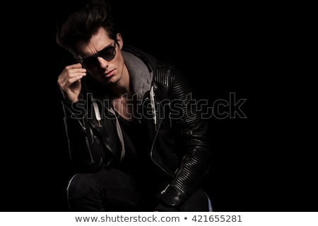 man in leather jacket posing seated on stool stock photo © feedough