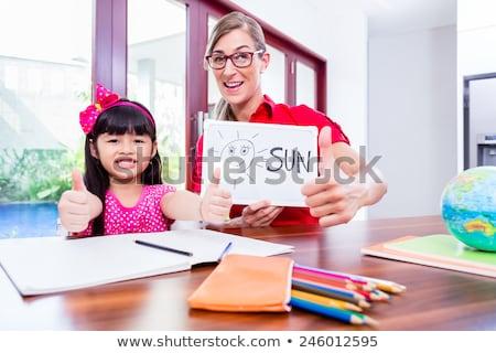 teacher giving language lessons to chinese child stock photo © kzenon