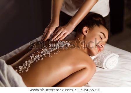 Woman enjoying a salt scrub massage Stock photo © wavebreak_media