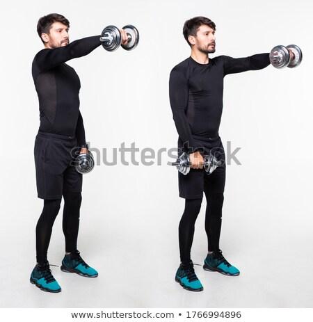 Genç erkek vücut geliştirmeci ağır ağırlık egzersiz Stok fotoğraf © zurijeta