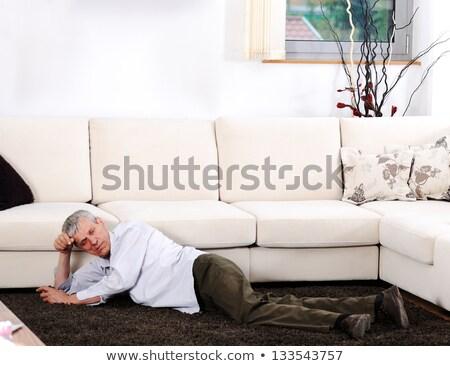 elderly man having heart attack lying on floor at home stock photo © zurijeta