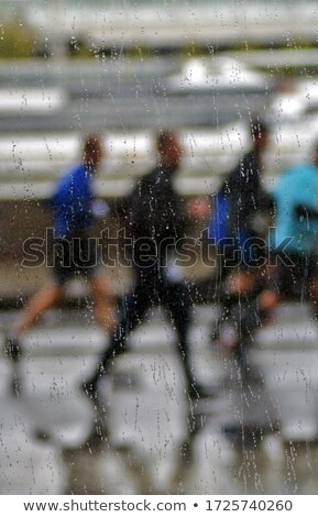 blur image of people running a marathon race through city stock photo © stevanovicigor