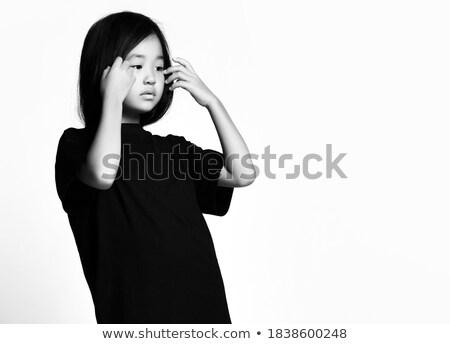 Pouty girl thinking Stock photo © MilanMarkovic78